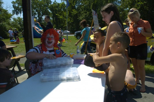 Children of Soldiers assigned to Headquarters and Headquarters Battalion of the Troy-based 42nd Infantry Division enjoy Family Day activities with Daisy the Clown at the Sullivan Jones Veterans of Foreign Wars Post here on Sunday August 12.