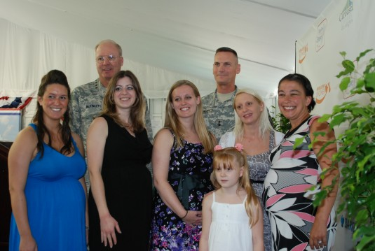 Gen. Craig McKinley, Chief of the National Guard Bureau, and Major General Patrick Murphy, the Adjutant General of New York, pose with five New York Army National Guard spouses who attended a baby shower hosted by the PGA and Barclay&rsquot;s Bank during
