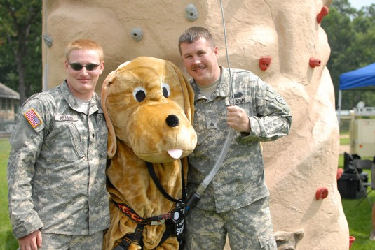 New York Army National Guard Sgt. Scott Kramer and Spc. Robert Juliano, members of the New York National Guard Counterdrug Task Force, pose with the Binghamton Humane Society mascot during a community event on August 25.