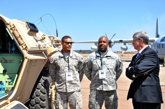 U.S. Ambassador to South Africa Donald H. Gips speaks with New York Army National Guard Sgt. Anewrys Rosario, (left) and Spec. Sebastian Petion, (center), 442 Military Police Company from Queens, N.Y. during the opening day of the 2012 Africa Aerospace an