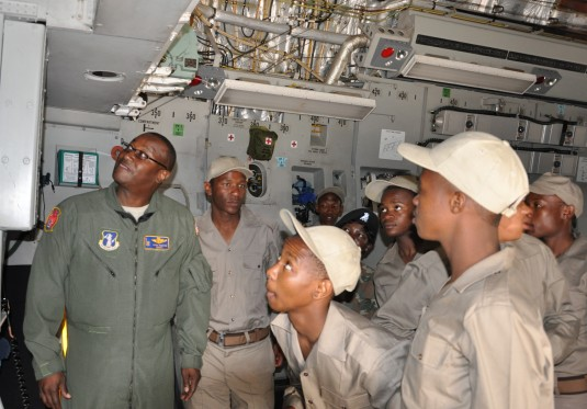 New York Air National Guard Senior Master Sgt. Jerry Ingram, a loadmaster from the 105th Airlift Wing, Newburgh, N.Y., explains the C-17 Globemaster III's capabilities to members of the Young Lions, a South Africa Youth Development program.