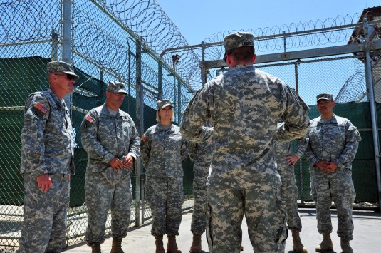 Brig. Gen. James Lettko, Joint Task Force Guantanamo Deputy Commander (far left) and Col. Paul Sausville (second left), the New York National Guard's Senior Judge Advocate, Joint Force Headquarters in Latham, along with other members of the New York Army