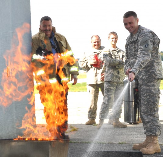 Albany International Airport Fire Captain Greg Gordon shows New York Army National Guard Private Ryan Couture, a UH-60