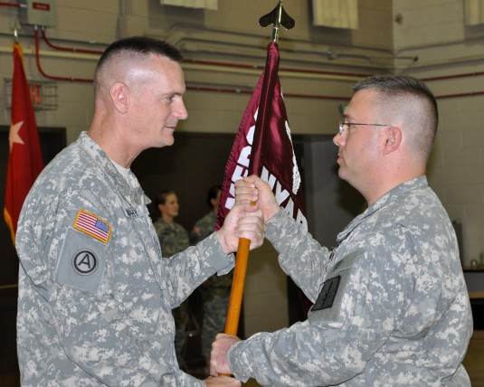 Col. Colonel James Coleman accepts the guidon of the New York Army National Guard Medical Command from Major General Patrick Murphy, the Adjutant General of New York and Commander of the New York Army National Guard, during Change-of-Command ceremonies he