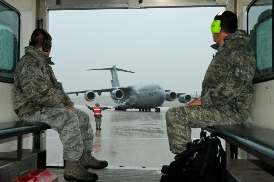 New York Air National Guard  maintainers belonging to the 105th Airlift Wing watch a 17 Globemaster III, taxi out for a late morning flight Oct. 19, 2012.