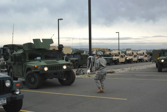 New York Army National Guard Soldiers assigned to the 206th Military Police Company prepare to move out on a road march from New York State Division of Military and Naval Affairs Headquarters here to the Farmingdale Armed Forces Reserve Center as part of
