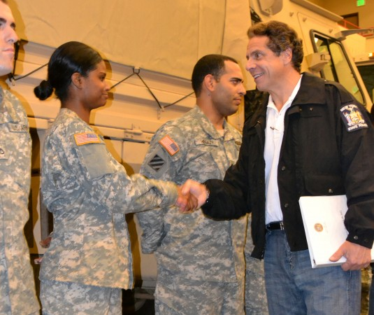 New York Army National Guard Soldier Lydia Graham, a member of the 442nd Military Police Company from Brooklyn New York speaks with Gov. Andrew M. Cuomo as he inspected National Guard Soldiers deployed to the Farmingdale Armed Forces Reserve Center in res