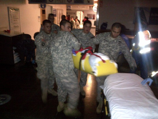 Soldiers assigned to the New York Army National Guard's 3rd Platoon of Company A, 1-69th Infantry rush a patient from Bellevue Hospital on Wednesday night, Oct. 31 after the decison was made to evacuate the hospital.