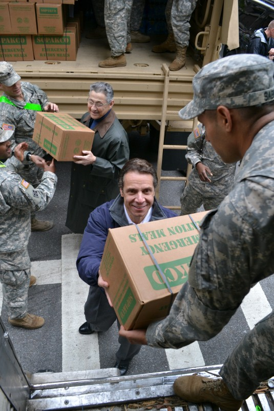 New York Governor Andrew Cuomo and Assembly Speaker Sheldon Silver work with New York Army National Guard Soldiers of the 1st Battalion 69th Infantry at the Lexington Avenue Armory load emergency food supplies for distribution to New York City residents o