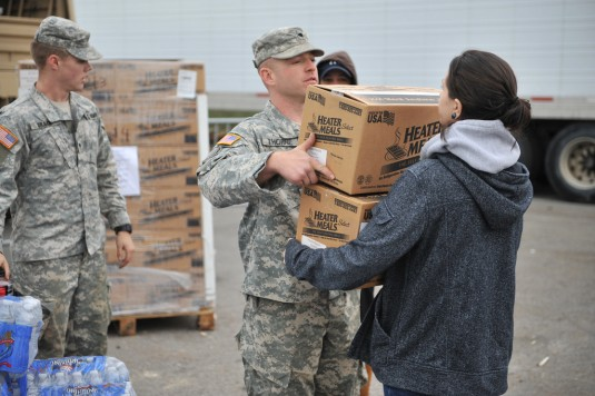 New York Army National Guard Soldiers pass out emergency food rations to local residents here during a Point Of Distribution mission on Monday, Nov. 5.