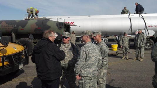 New York Army National Guard logistics experts speak with New York City Office of Emergency Management officials at the Logistical Support Area established here on Tuesday, Nov. 5, as a FEMA tanker tops off a Guard fueler that will go on to fuel city and