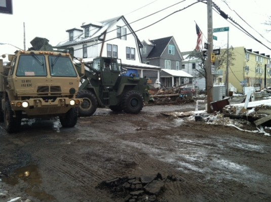 Members of the 204th Engineer Battalion work to clear streets in Far Rockaway on Nov. 8. The Queens community was battered by Hurricane Sandy when it hit on Oct. 30.