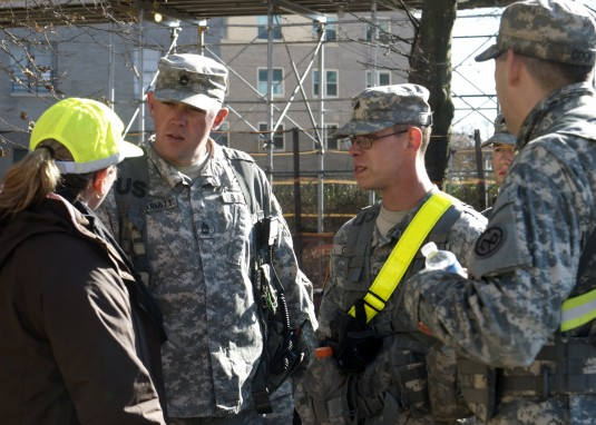 New York Army National Guardsmen with B Troop, 2nd Squadron, 101st Cavalry Regiment, speak with FEMA community relations specialist Nora Gomez in Coney Island New York, N.Y., Nov. 9, 2012.