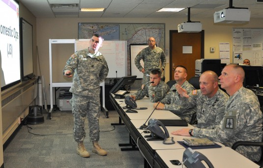 Army National Guard Command Sgt. Major Brunk Conley(second from right) gets a briefing on New York National Guard operations in New York City and Long Island during a visit to the Joint Operations Center here on Wednesday, Nov. 13.