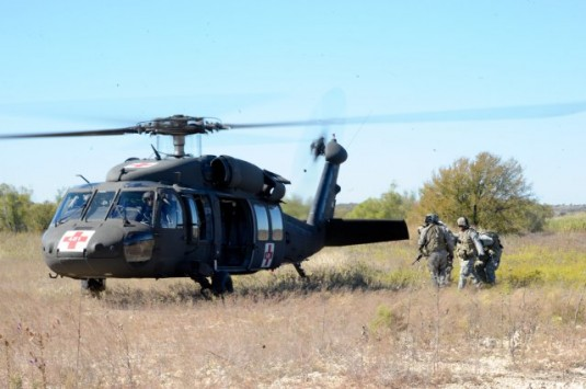 Black Hawk helicopter crew members of Company F, 1-169th General Support Aviation Battalion (Air Ambulance), an  Army National Guard unit with Soldiers from Missouri, New York, New Hampshire and Pennsylvania, prepare to medically evacuate a simulated casu