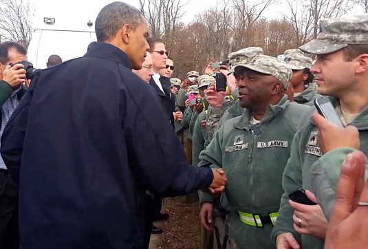 President Barack Obama greets members of the New York Army National Guard on duty in New York City in response to Hurricane Sandy during his visit to the city on Thursday, Nov. 15.