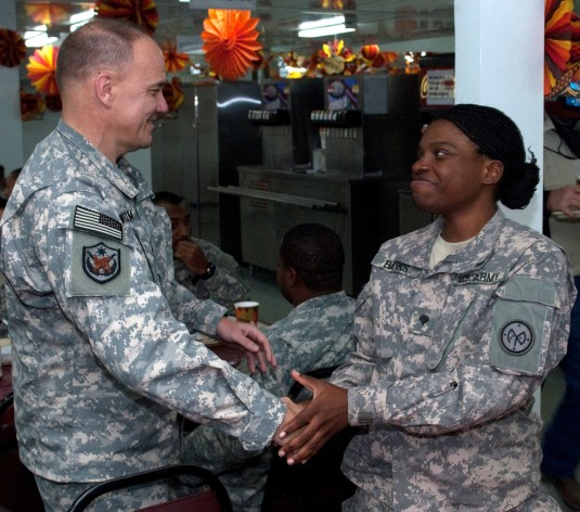 Maj. Gen. Steven N. Wickstrom, commander of the New York Army National Guard's 42nd Infantry Division (left), shakes hands with Spc. Vanessa Banks, of Niagara Falls, N.Y. (right) during Wickstrom