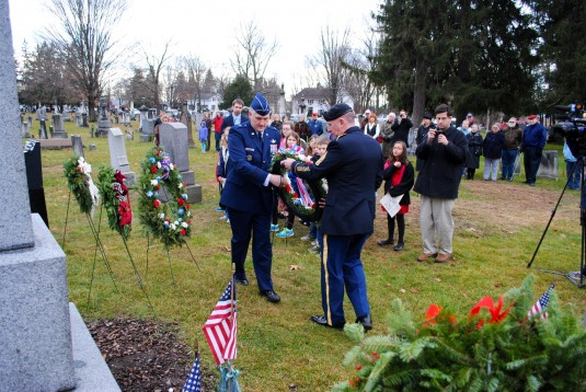 New York Air National Guard Brigadier General Robert Lovell, Special Assistant to the commander of the New York Air National Guard , and New York Army National Guard Command Sgt. Major Frank Wicks present a wreath from the White House at a ceremony honori