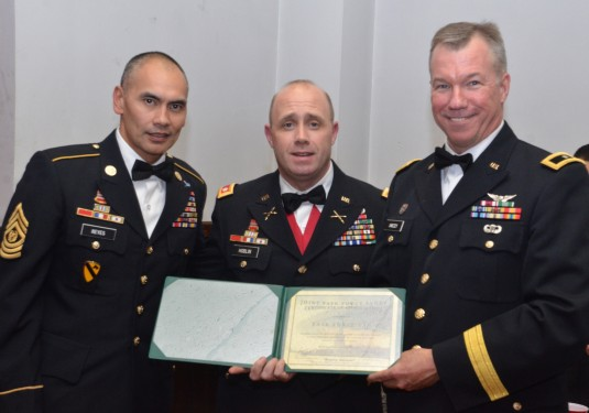 Brig. Gen. Michael Swezey presents a certificate of appreciation to Lt. Col. Michael Hoblin, center, and Command Sgt. Maj. Arnold Reyes