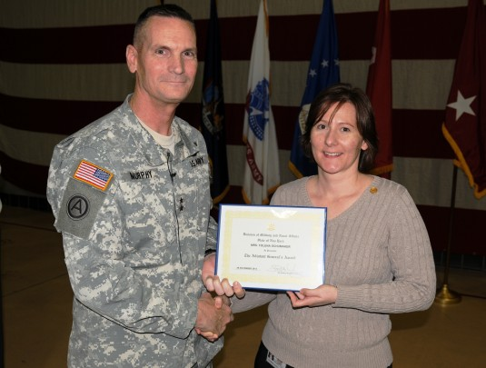 Major General Patrick Murphy, the Adjutant General of New York, presents Division of Military and Naval Affairs employee Folena Schumaker with the Adjutant General's Award during the headquarters  National Guard Birthday Celebration on Dec. 13.