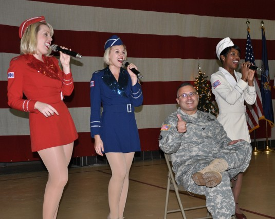Members of the Liberty Bells, a USO Show Troupe sign to New York Army National Guard Col. David Martinez during Christmas lunch festivities on Dec. 19.