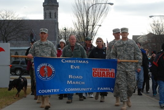 New York Army National Guard Soldiers, families, friends and supporters from the community march in the the 9th annual Christmas Eve roadmarch.