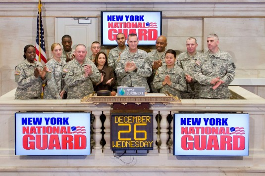 Major General Patrick Murphy (center) the Adjutant General of New York, is joined by New York Army and Air National Guard memembers in ringing the opening bell at the New York Stock Exchange on Wednesday, Dec. 26, kicking off the trading day.