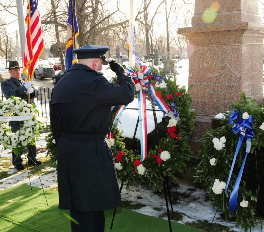 Col. Kevin Rogers, Maintenance Commander of the New York Air National Guard's 107th Airlift Wing, presents a wreath honoring President Millard Fillmore-- who served from 1850 to 1853-- at his gravesite in Forest Lawn Cemetery on January 7, 2013.