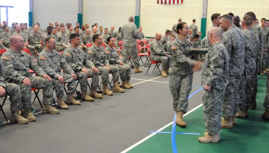 A New York Army National Soldier who was attached to Headquarters Company of the 2nd Battalion 108th Infantry during the unit's deployment in Afghanistan in 2012 receives awards from the commander during Freedom Salute Ceremonies held here on Saturday, Ja