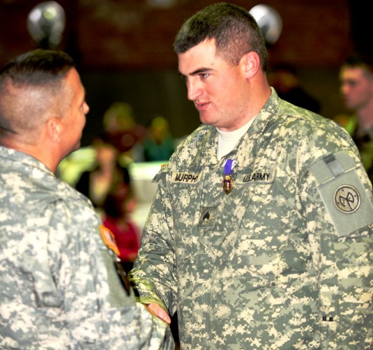 New York Army National Guard Sgt. Kieran Murphy, receives the Purple Heart in recognition of wounds received when insurgents attacked his vehicle with an improvised explosive device in July 13, 2012, during a ceremony here on Jan. 13.