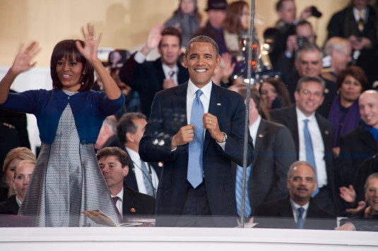 President Barack Obama and First Lady Michelle Obama salute perfomers in the Inagural Parade as they pass the reviewing stand on Jan. 20 in a photograph taken by New York Air National Guard Tech Sgt. Eric Miller.