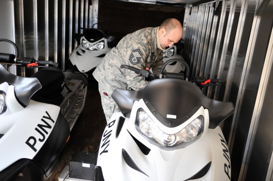 Senior Master Sgt. Joseph Spadavecchia checks over one of several snowmobiles operated by the 103rd Rescue Squadron