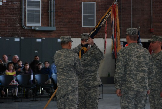 New York Army National Guard Maj. Gen. Steven Wickstrom, Commander of the 42nd Infantry Division, presents the unit colors of the 2nd Battalion, 108th Infantry Regiment to Lt. Col. Christopher Cronin during his change of command ceremony here Feb. 9.