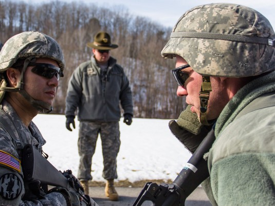 Staff Sgt. Carlos Perez and Sgt. Daniel Tucker, forward observers in the HHC 42nd Combat Aviation Brigade, NY Army National Guard, call in an indirect fire report during an exercise while.Sgt First Class Charles Crouchman and Staff Sgt. Curtis Brand, dril