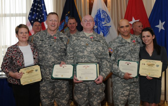 Members of the New York Stability Transition Team, who deployed to Afghanistan in 2012 to work with government officials and local police, pose during an awards ceremony held here on March 16.