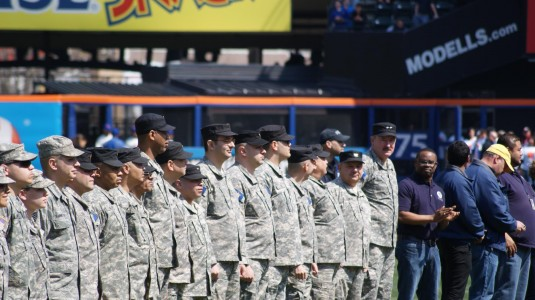 Members of the New York Guard, the state's volunteer defense force, stand in formation on April 1 during Opening Day ceremonies here which honored Hurricane Sandy responders.