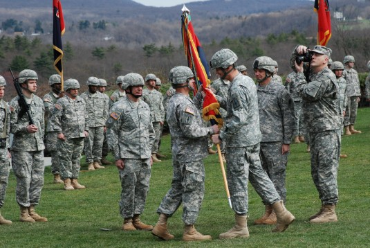 New York Army National Guard Brig. Gen. Harry E. Miller receives the unit colors of the 42nd Infantry Division