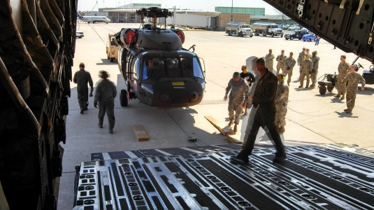 New York Army National Guard Soldiers assigned to Army Aviation Support Facility #1 here work togther with airmen from the 105th Airlift Wing to load a UH-60 Blackhawk helicopter on board a New York Air National Guard C-17 as the helicopter is shipped awa