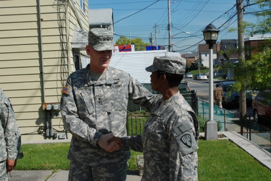 Maj. Gen. Patrick Murphy, The Adjutant General congratulates Spc. Maurisa Massiah prior to her mobilization ceremony