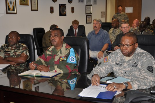 New York Army National Guard Col. Reginald Sanders (left) the commander of the 369th Sustainment Brigade, joins Dr. Jeannot Essono Engueng (center) from the Military Forces of Central Africa, and Col. Frederick Ndjonkep, a member of the Military Operation