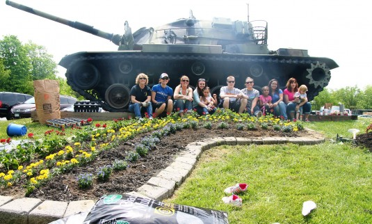Members of the New York National Guard Youth Program plant a rainbow of red geraniums, yellow marigolds and blue lobelias to celebrate Armed Forces Day May 18 at the headquarters 42nd Infantry Division Headquarters in Troy, N.Y.