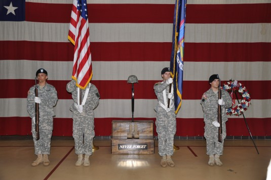LATHAM-- A color guard presents arms during the annual Division of Military and Naval Affairs pre-Memorial Day commemoration at state headquarters on Thursday May 23.