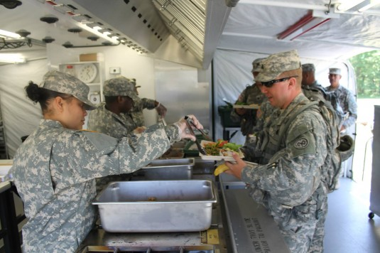 Soldiers assigned to Company F 427th Brigade Support Battalion based in Farmingdale serve meals for fellow troops here June 2 during the Armys regional Philip A. Connelly Food Service Competition.