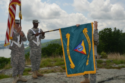 The new colors of  Camp Smith Training Site are unfurled on the highest point of ground on the post, overlooking the Hudson River, during a special  Unit Colors Uncasing and Repatching Ceremony on June 3rd 2013.