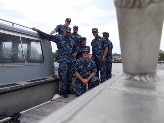 Members of the New York Naval Militia take a break during boat coxswain training off Long Island on Wednesday, June 26 aboard Patrol Boat 280.