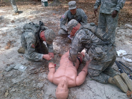 PFC Ryan Seigel and SPC John Dolengewicz (B Co, 2nd Plt, 2nd Squad) conduct an evaluation of a casualty during the