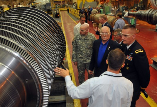 Major General Patrick Murphy,the Adjutant General of New York, examines a turbine while visting General Electric's Power Systems here on July 31.