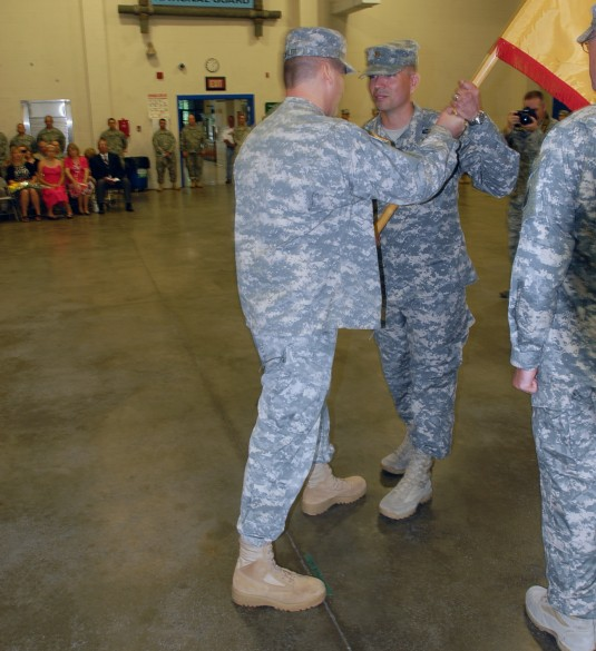 Major Scott Jessop accepts the colors of the New York Army National Guards 427th Brigade Support Battalion from Col. Joseph Bieler commander of the 27th Infantry Brigade Combat during change-of-command ceremonies on Friday August 9 at the Thompson Road Ar