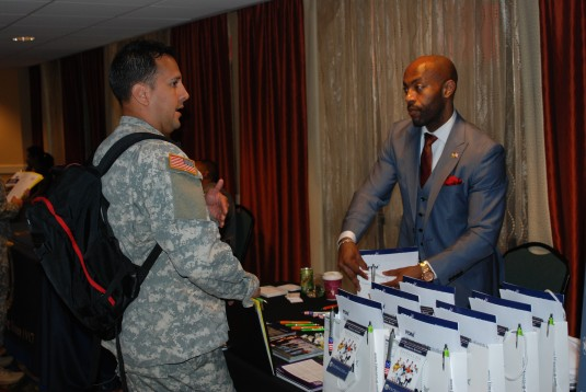 Sgt. Manual Tressandy, assigned to Company B, 101st Signal Battalion, talks about employment opportunities with Garry Harvey, head of veterans recruitment for FDM Group