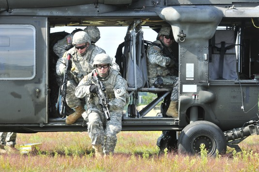 Soldiers assigned to 91st Military Police Battalion's protective service detail  exit a UH-60 Black Hawk helicopter during a joint training exercise with the New York Army National Guard 's  B Company 3rd Battalion 142nd Aviation Regiment (Assault